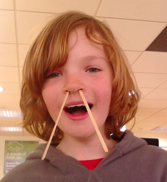 Boy with chopsticks in nose